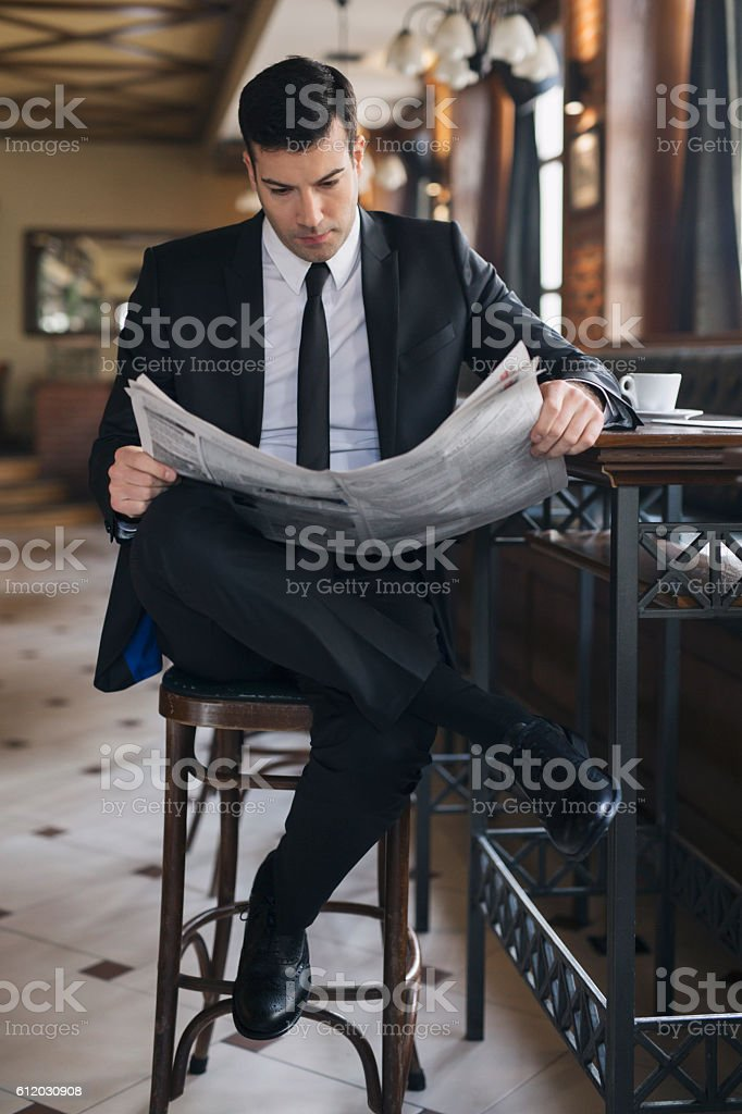 Daily press and morning coffee stock photo