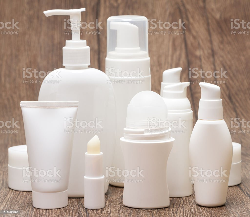 Daily skincare cosmetics on wooden surface stock photo