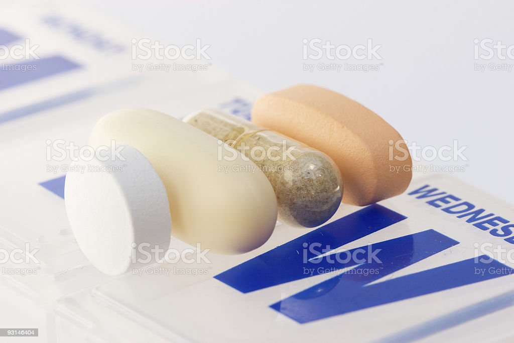 Daily vitamin and supplement pills stock photo