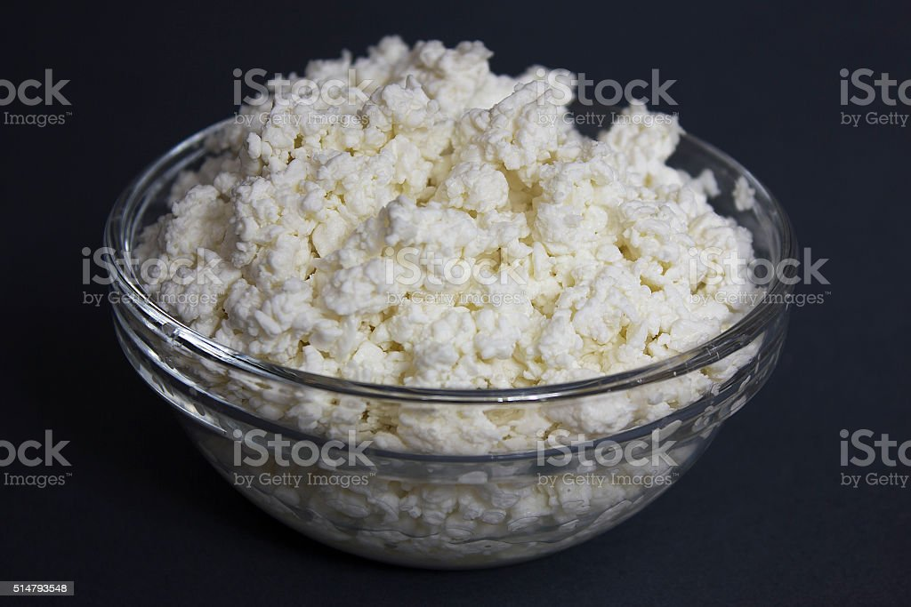 Dairy. Cottage cheese in a glass bowl stock photo