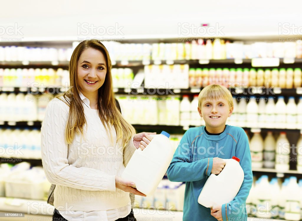 Dairy is delicious! Happy mother and son shopping for milk royalty-free stock photo