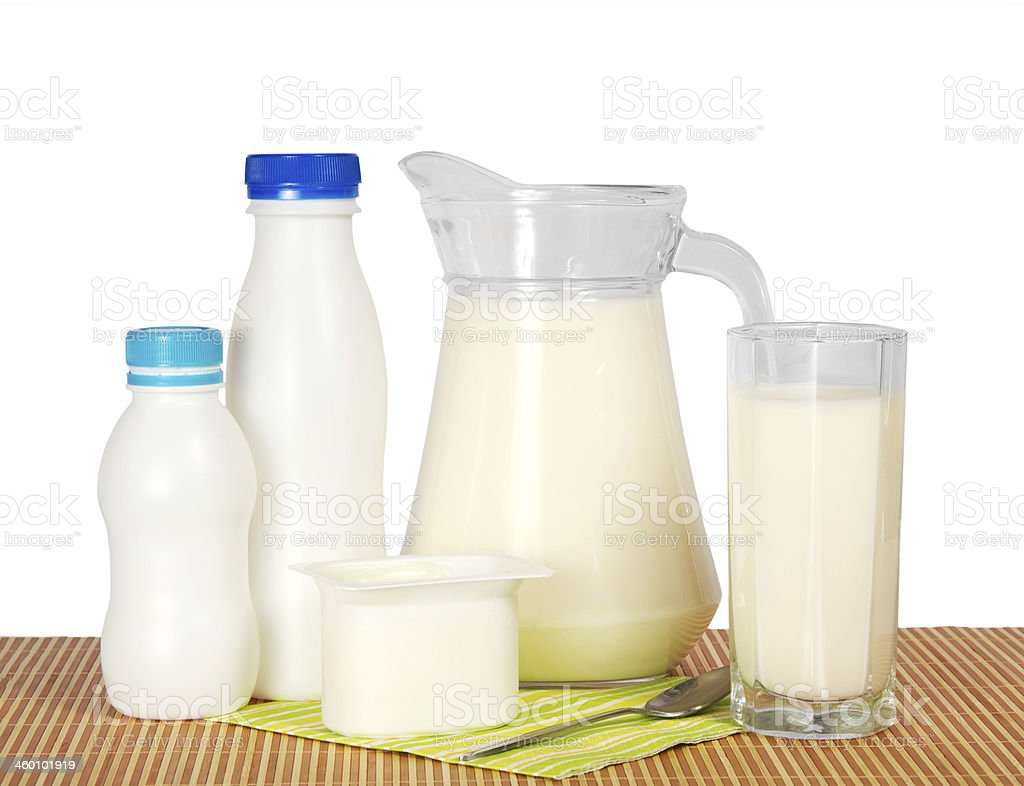 Dairy products and napkin on the bamboo cloth stock photo