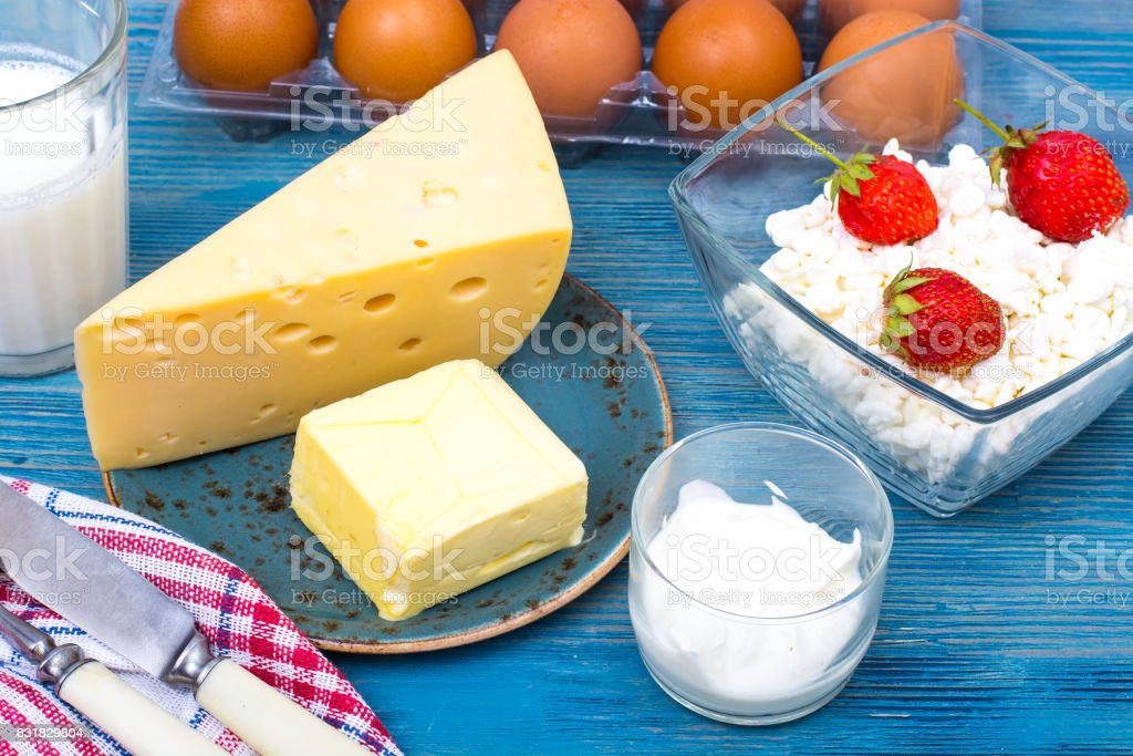 Dairy products as background of healthy food on blue stock photo