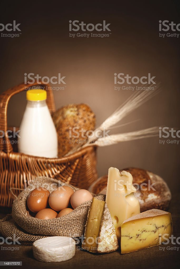 Dairy products, bread and eggs on linen canvas. royalty-free stock photo