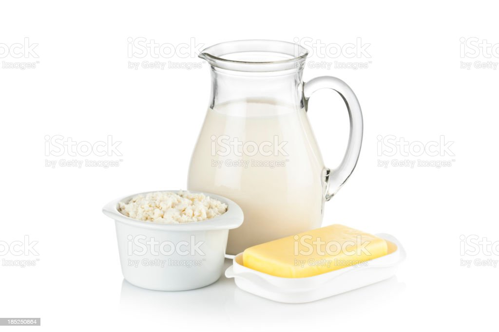 Dairy Products, milk, ricotta and butter shot on white backdrop royalty-free stock photo