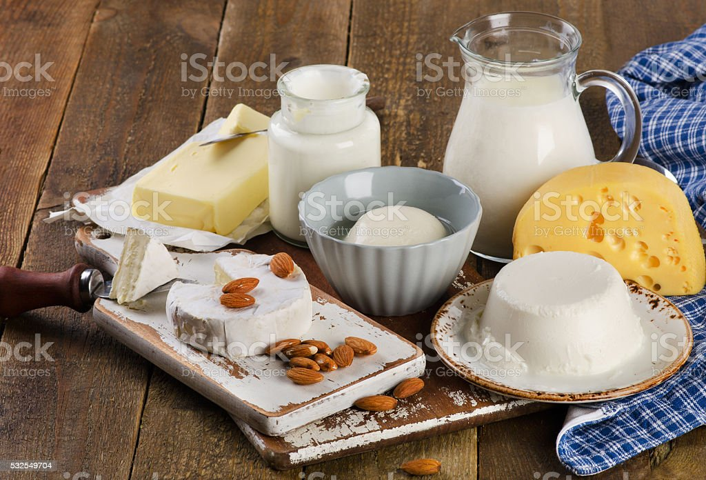 Dairy products on a wooden table stock photo