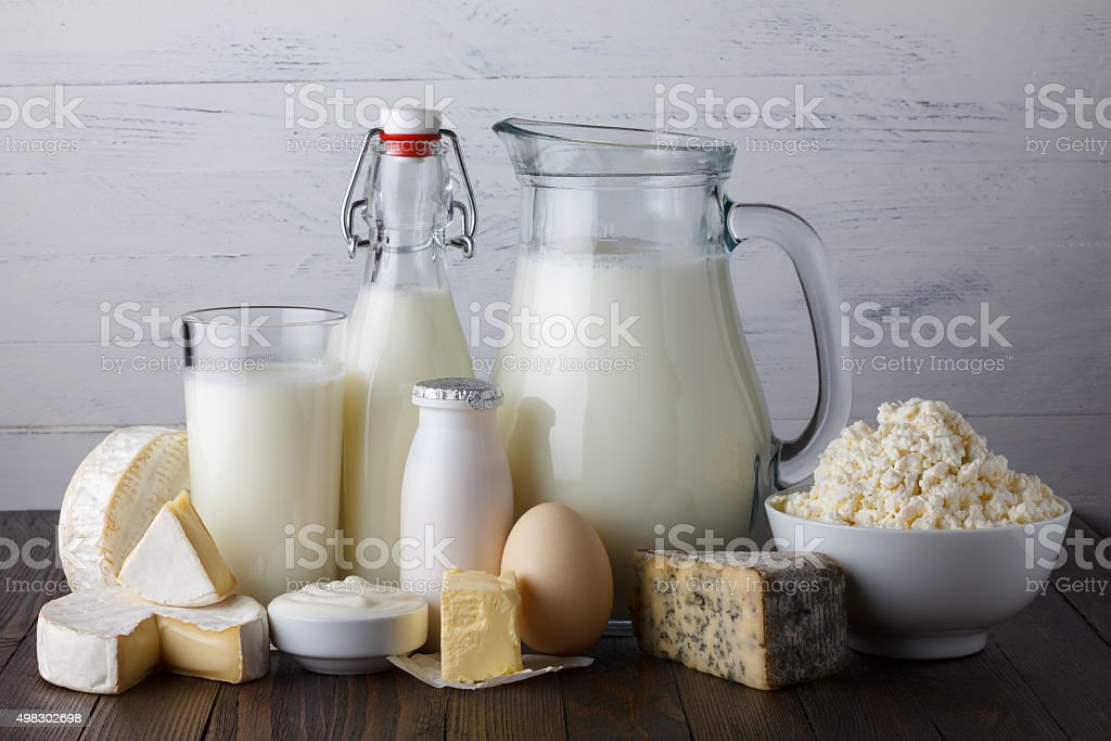 Dairy products on wooden table royalty-free stock photo