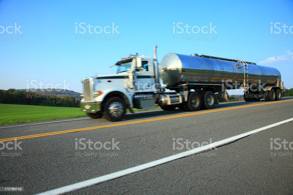 dairy tanker going fast on a country highway stock photo