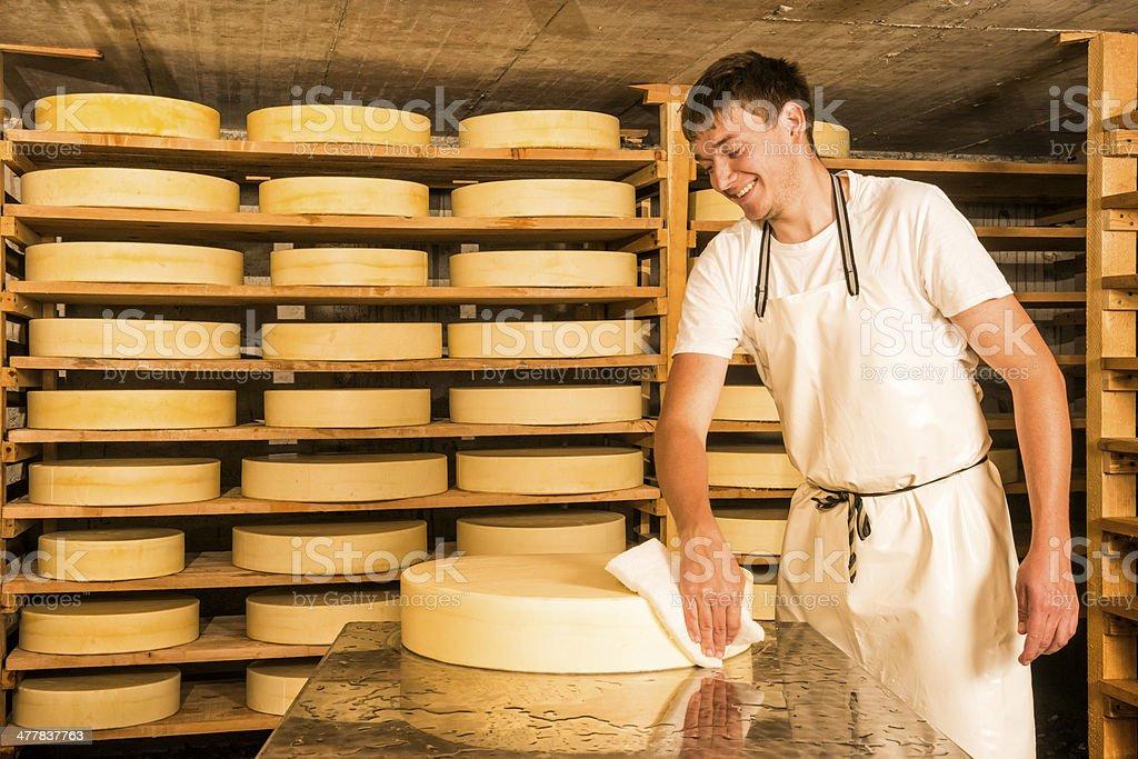 dairyman producing cheese on alpine dairy royalty-free stock photo