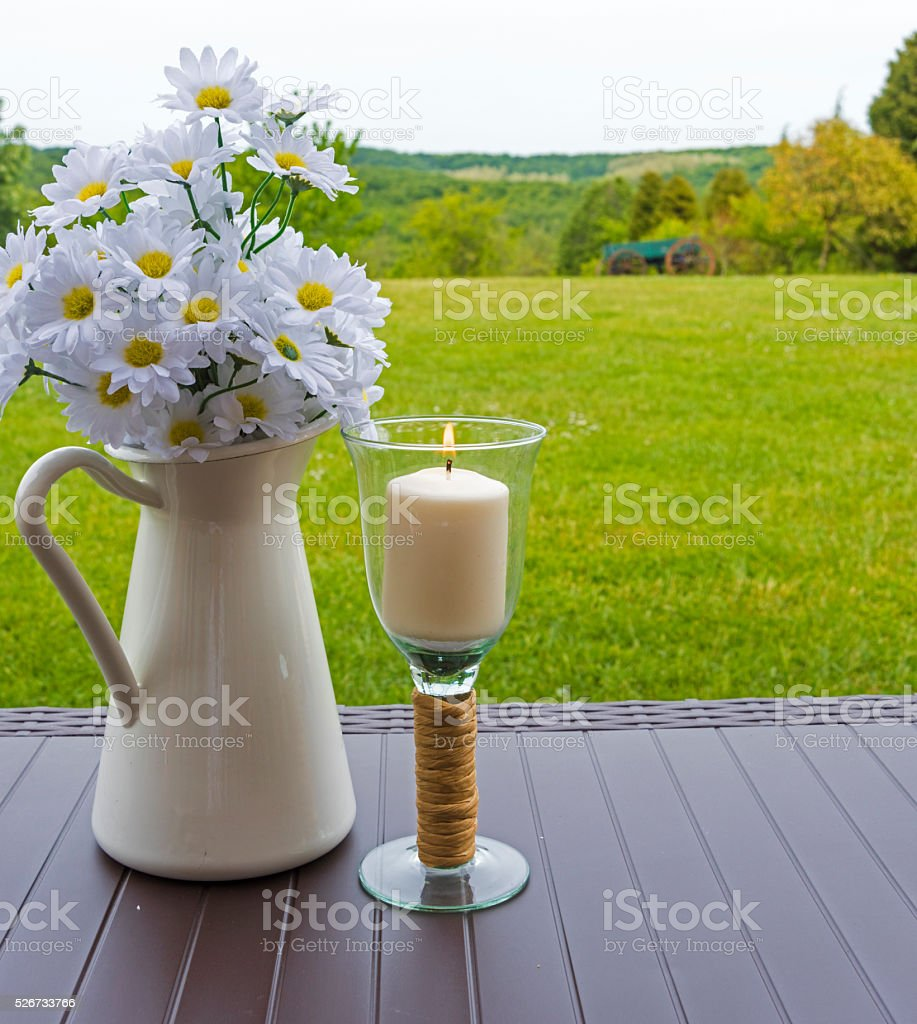 Daisies and Candle stock photo