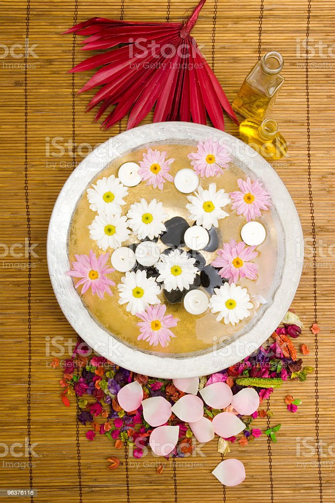 Daisies and spa candles royalty-free stock photo