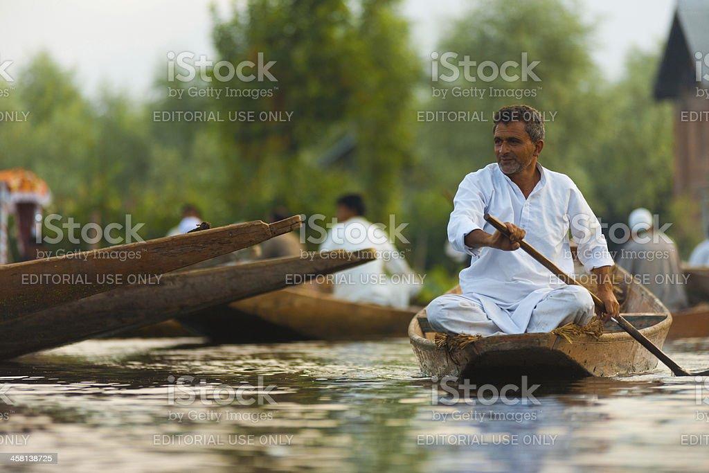 Dal Lake Floating Market Man Calmly Rowing stock photo