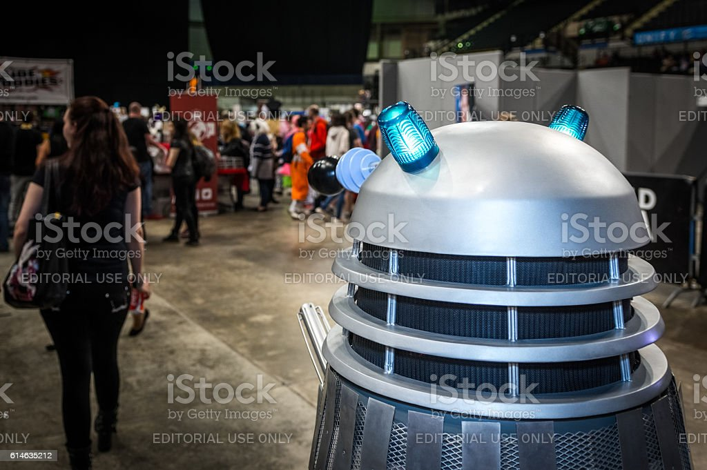 Dalek following a woman at the Yorkshire Cosplay Convention stock photo