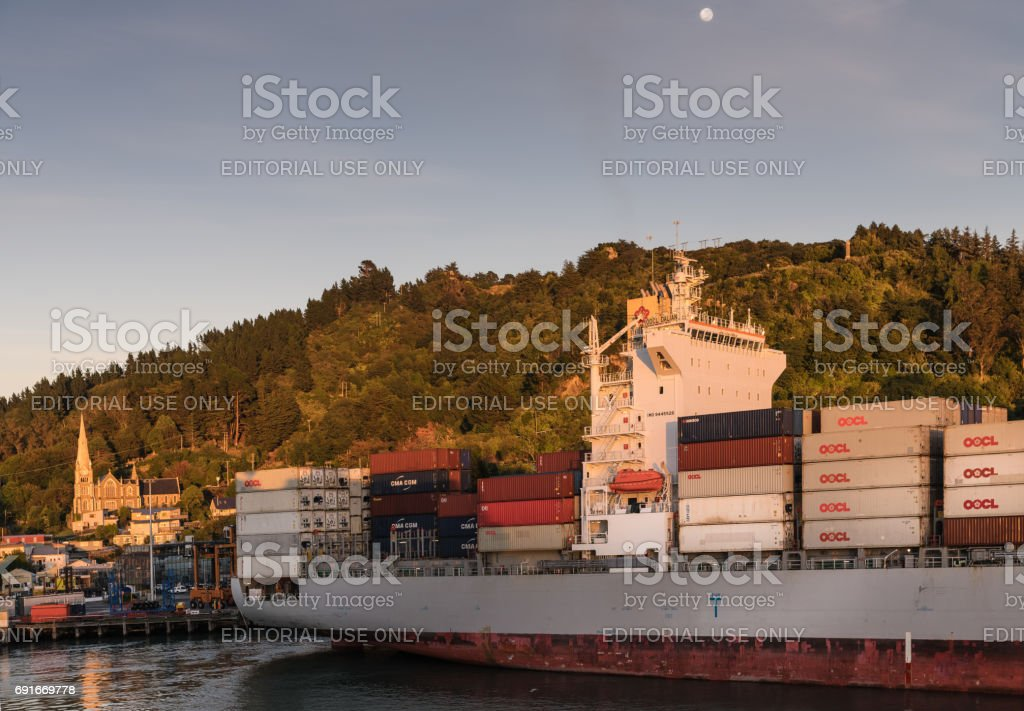 OOCL Dalian container ship docked at Port Chalmers, New Zealand. stock photo