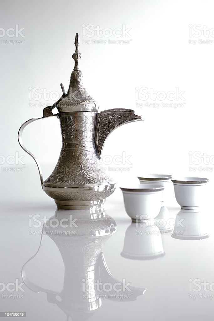 Dallah is a metal pot designed for making Arabic coffee stock photo