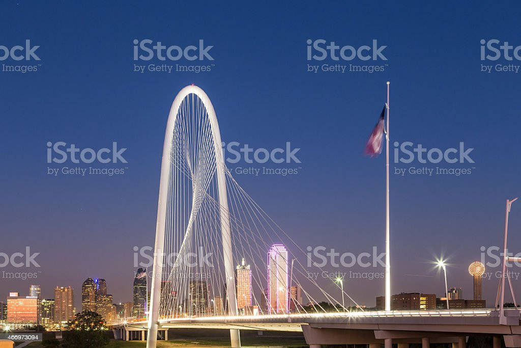 Dallas downtown skyline with Margaret hut hills bridge at night stock photo