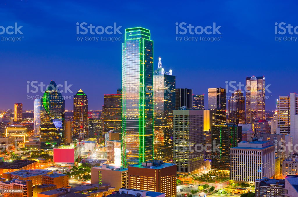 Downtown Dallas skyline aerial view at dusk with the reflection of...