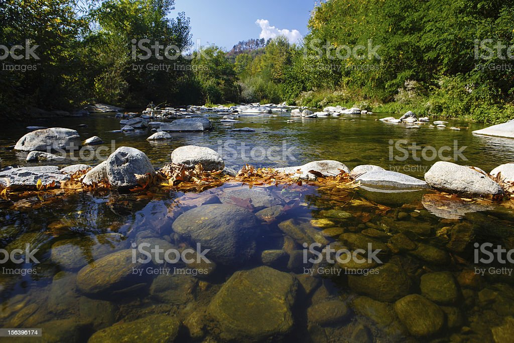 Dam from stones  on the mountain river royalty-free stock photo