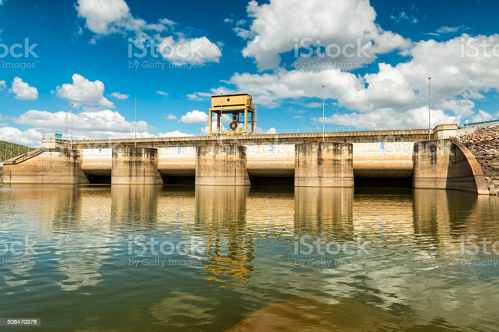 Dam on blue sky. stock photo