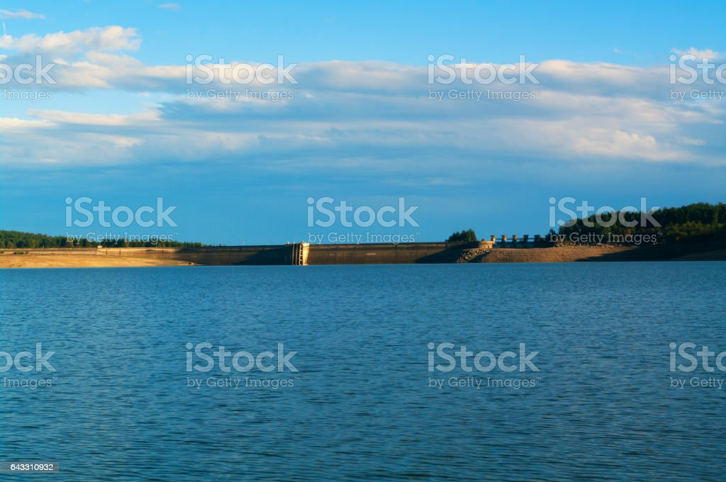 Dam reservoir. Water power plant. stock photo