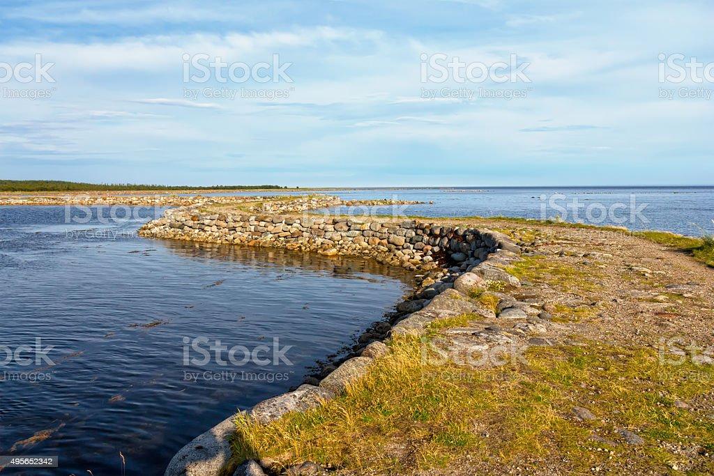 Dam to the island Muksalma, Solovetsky archipelago, Russia stock photo