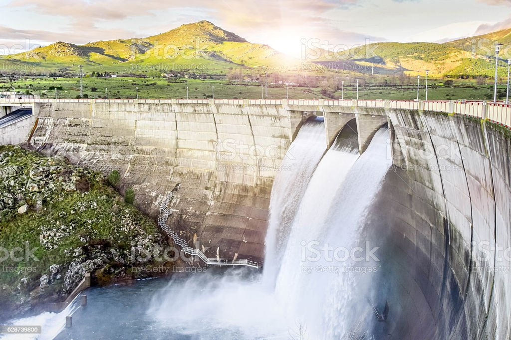 Dam unloading water stock photo