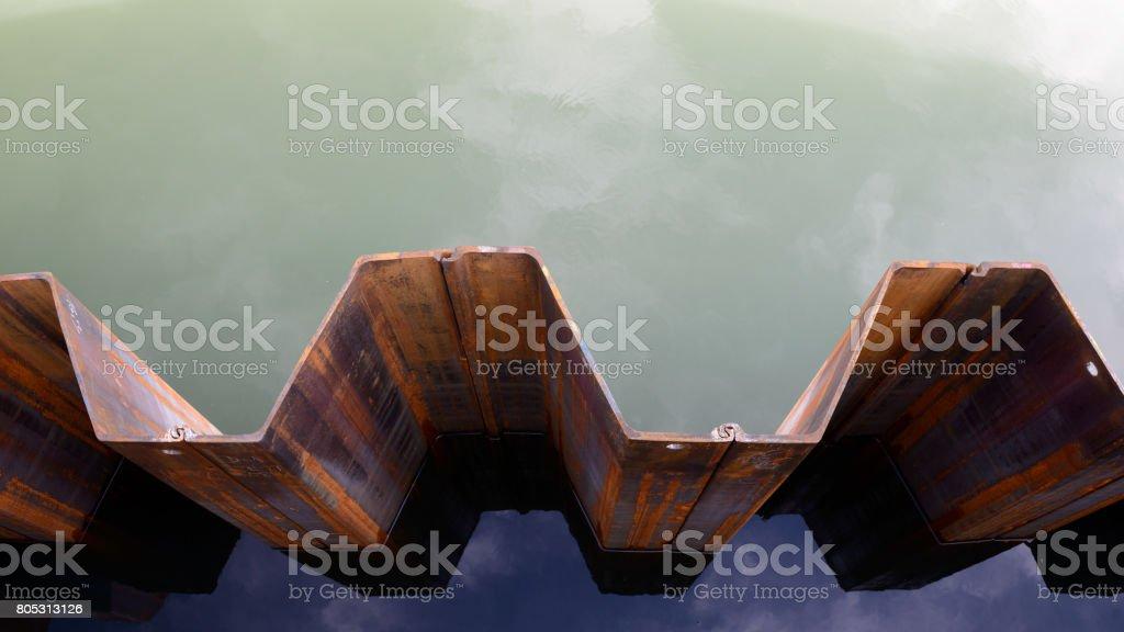 Dam wall of sheet piling, top view stock photo