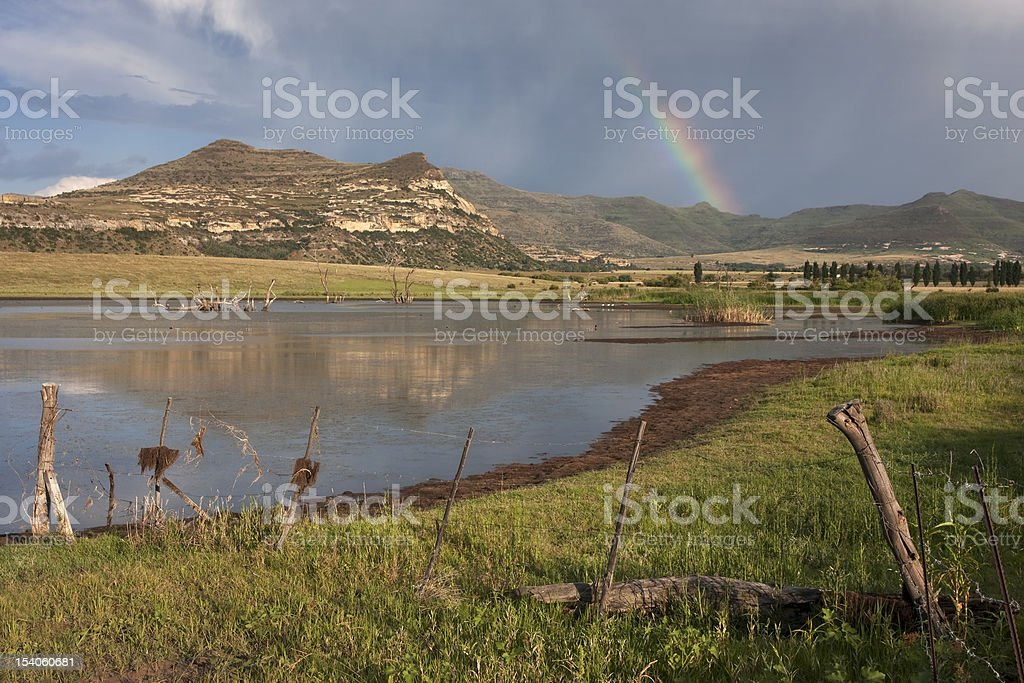 Dam with rainbow at Rosendal in South Africa stock photo