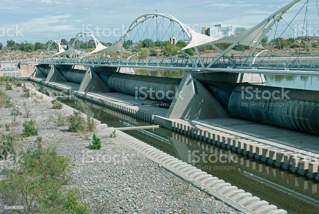 Dam with rubber bladders under walkway in Tempe AZ stock photo