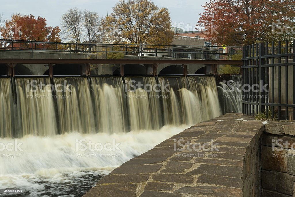 Dam with water flowing over stock photo