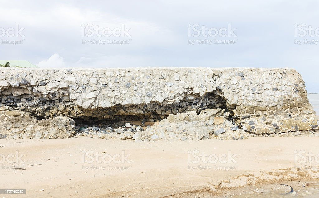 Damage of a stone seawall royalty-free stock photo