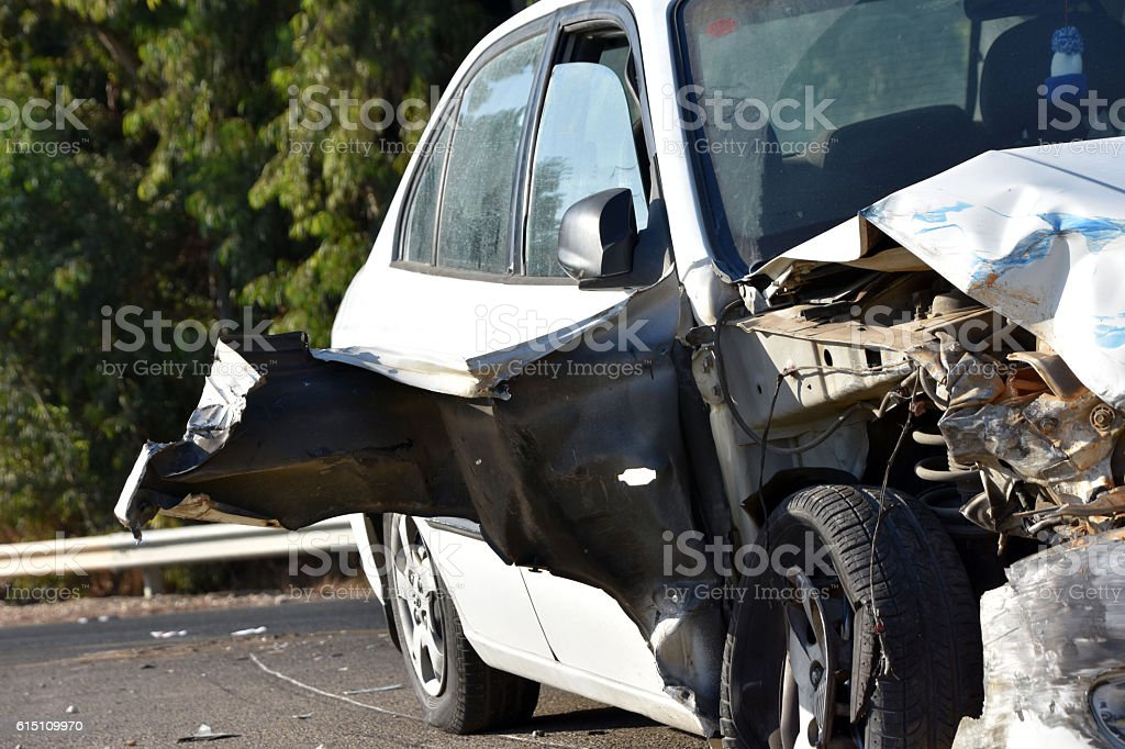 Damage to the front of the vehicle after a car accident stock photo