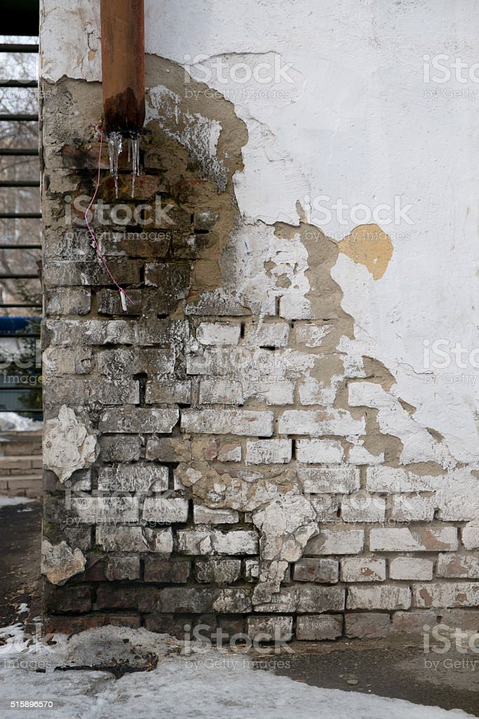 Damage to the outer wall of the house stock photo