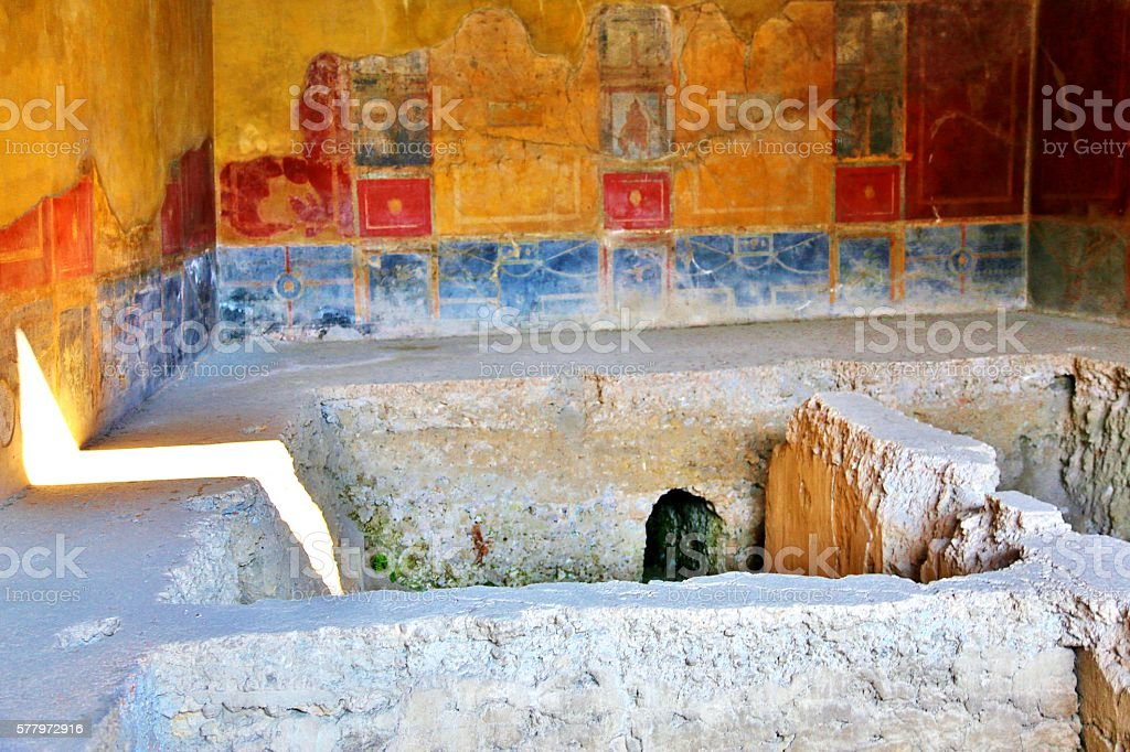 Damaged Ancient Room With Colorful Walls stock photo