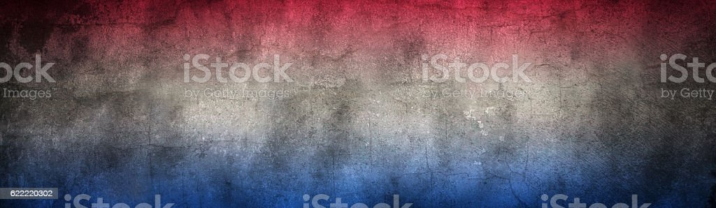 Damaged and distressed red white and blue stock photo