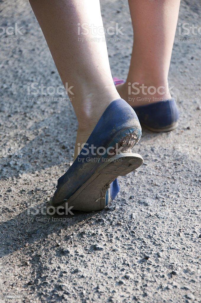 Damaged bottom of shoe close up / Walking royalty-free stock photo