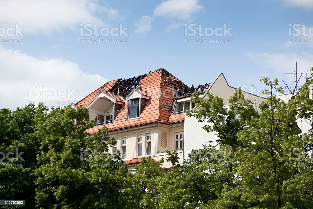 Damaged Building Roof from Buring Fire stock photo