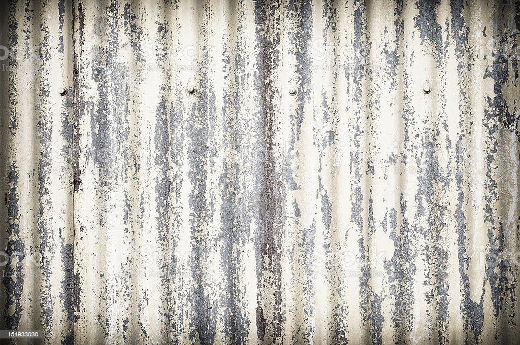 Damaged Corrugated Metal Surface Background royalty-free stock photo