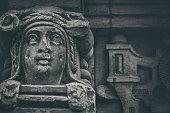 Damaged face of a sculpture
