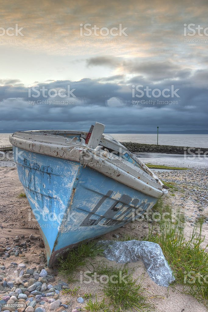 Damaged fishing boat stock photo