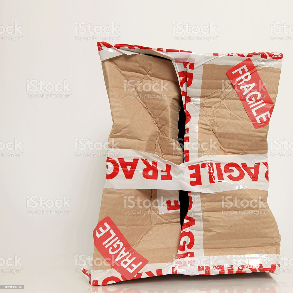 Damaged fragile parcel stock photo