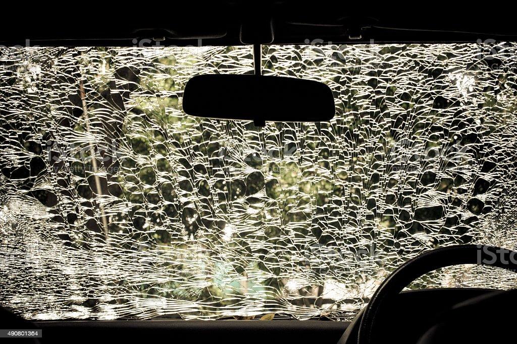 Damaged glass (car windshield) inside car stock photo