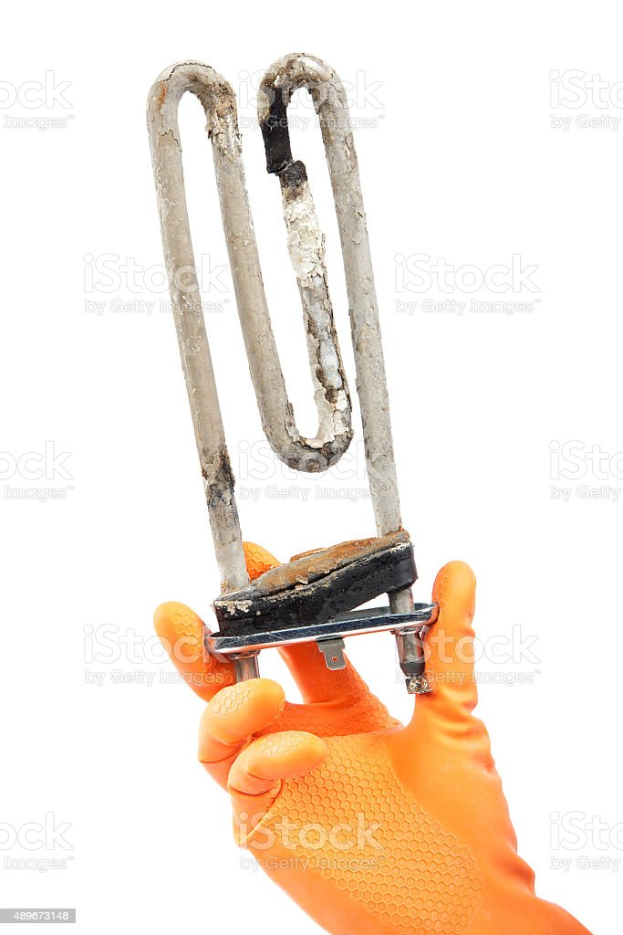 Damaged heating element of the washing machine in hand stock photo