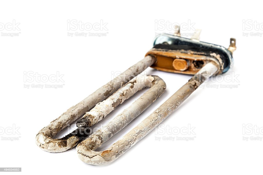 Damaged heating element of the washing machine. stock photo