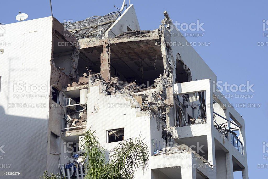 Damaged house - hit by rocket stock photo