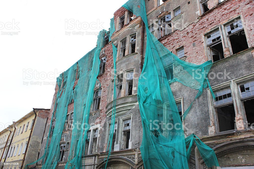Damaged house in need of renovation stock photo