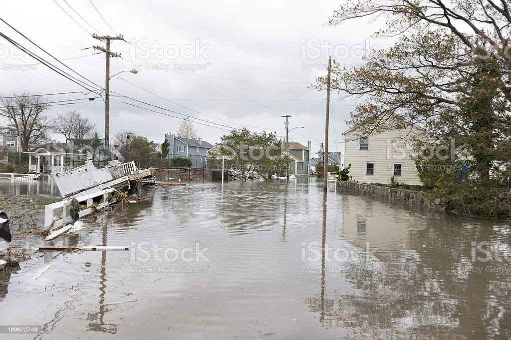 Damaged houses and flooded streets after Hurricane Sandy stock photo