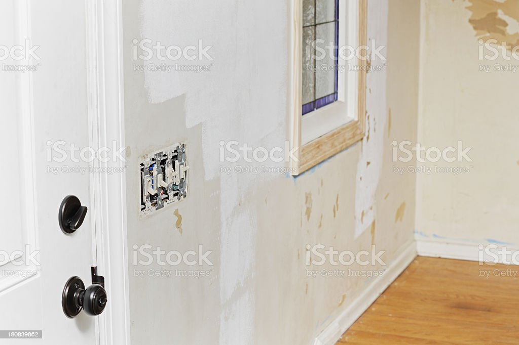 Damaged Interior Wall After Old Wallpaper Removal stock photo