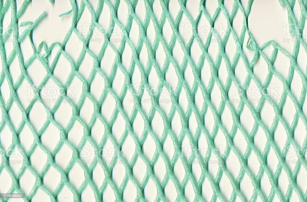 Damaged plastic mesh royalty-free stock photo