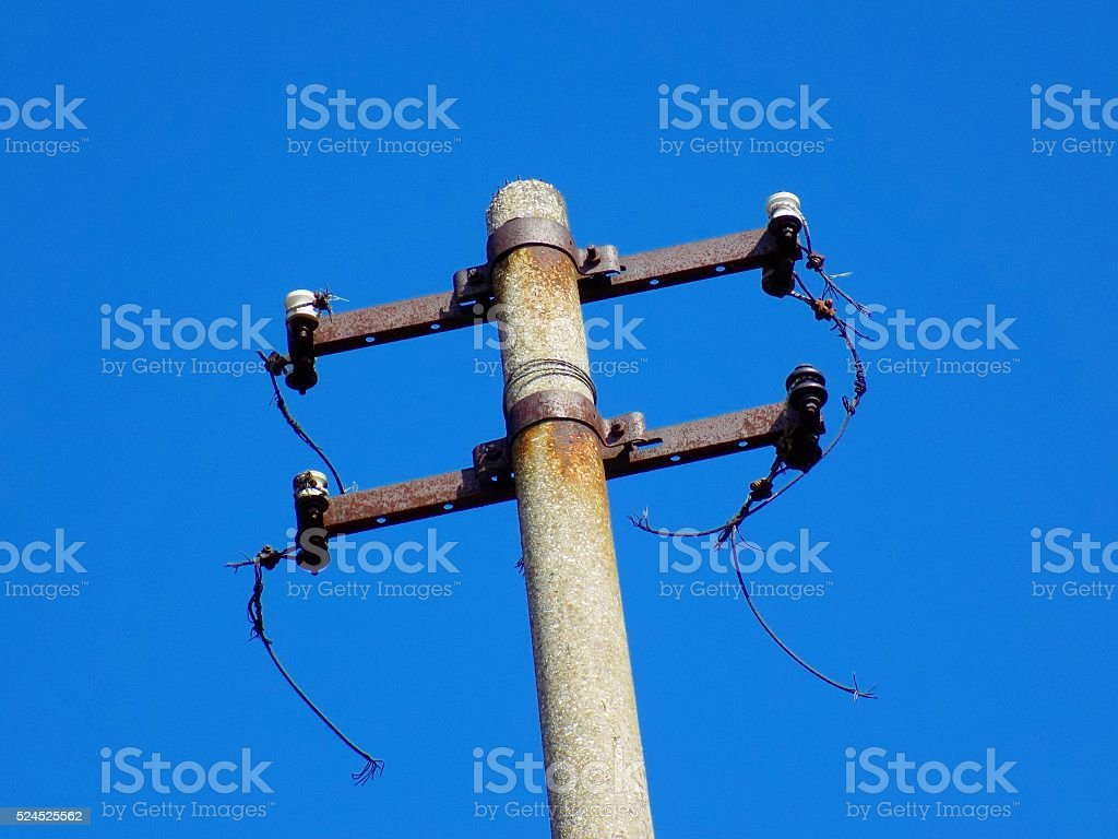 Damaged Power line column without cables stock photo